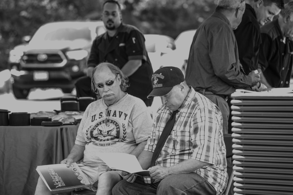 "Tom Glassmire (left) sitting with Chris ""Cappy"" Leos at the June 29th Gordon H. Mansfields Veterans Community dedication ceremony in Leeds, MA."