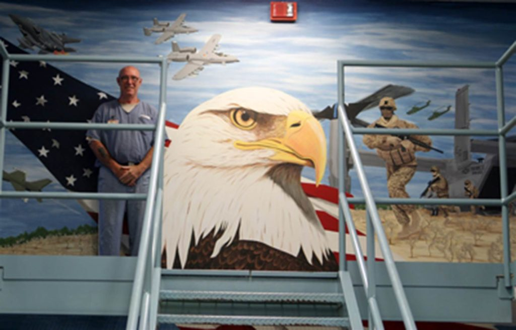 Inmates in Florida's veteran dorms paint murals representing the service branches on prison wards.