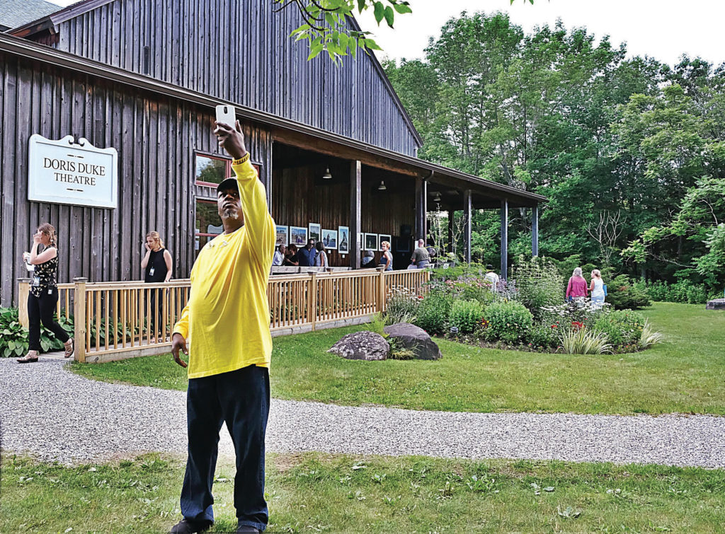"""NINA COCHRAN - THE BERKSHIRE EAGLE  Gilbert Carr taking a selfie in front of the Doris Duke Theatre, where the group saw performances of Roy Assaf's """"Six Years Later"""" and """"The Hill."""" Becket, Mass. July 15, 2017."""